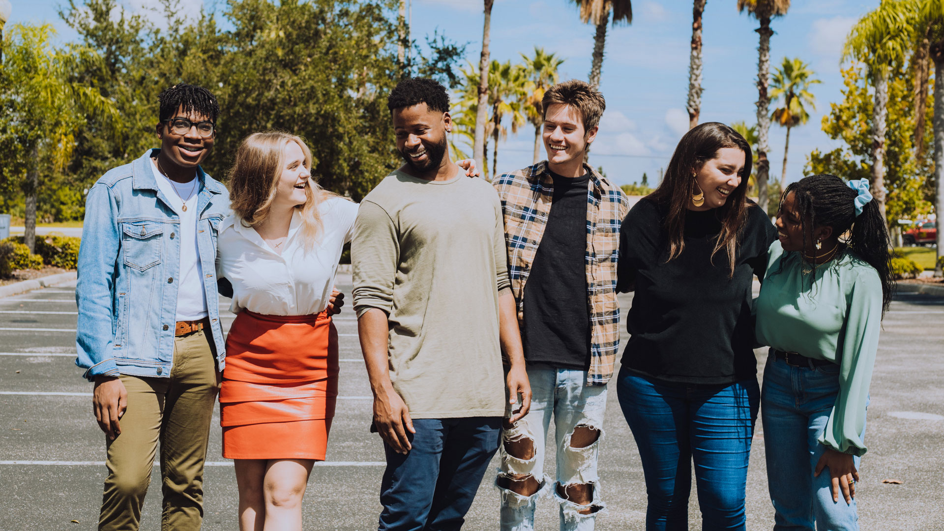 A group of people laughing and looking at each other.
