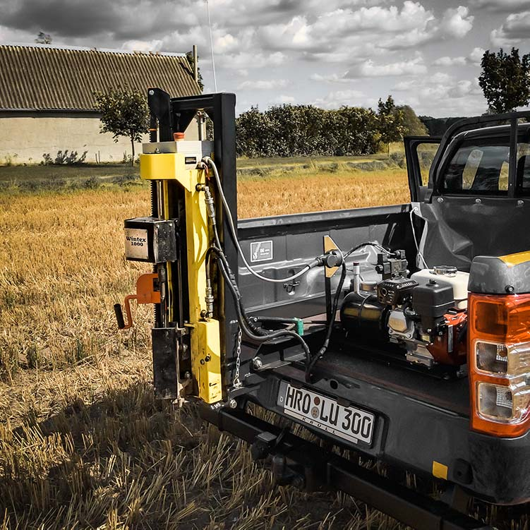 Wintex 1000 automatic soil sampler installed on the back of a pickup truck