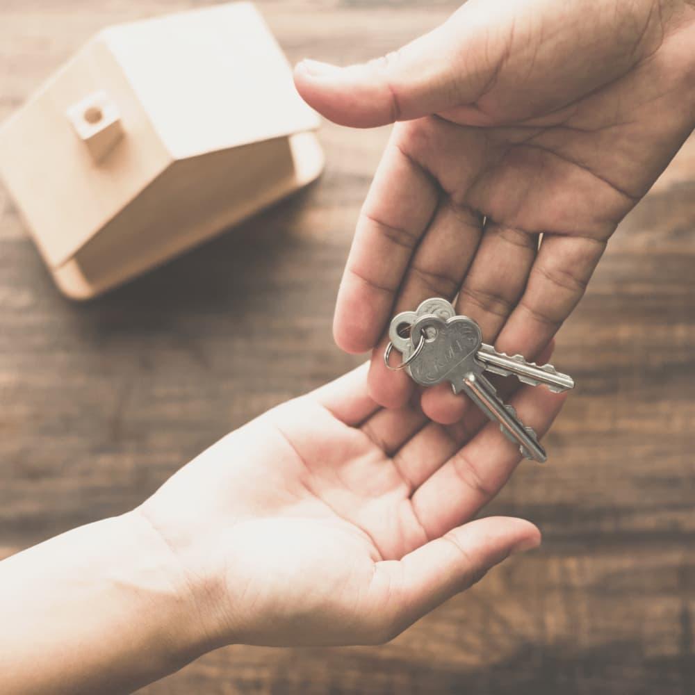 handing rental property keys to resident