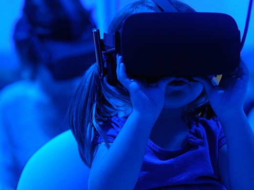 girl with VR goggles on