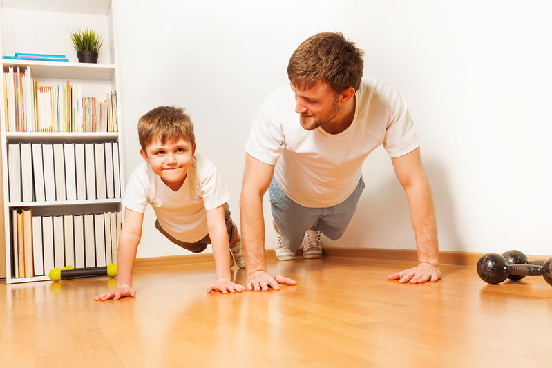 Father and son getting ready to do a home workout.