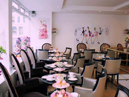 inside b bakery with tables set for afternoon tea