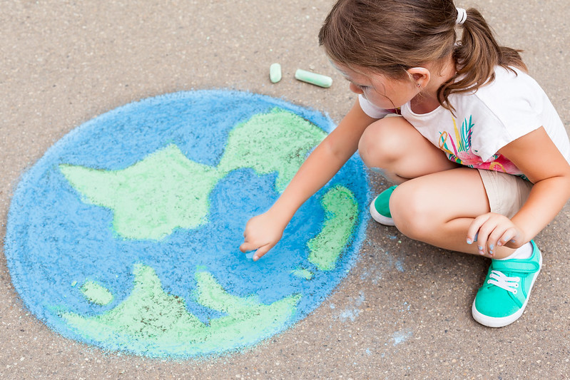 Girl drawing the earth as part of the geography games