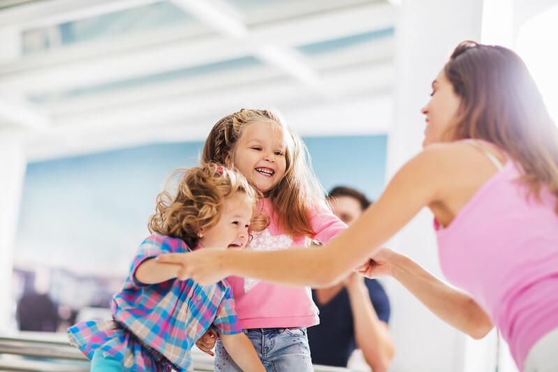 Mum teaching children how to do ballet at home