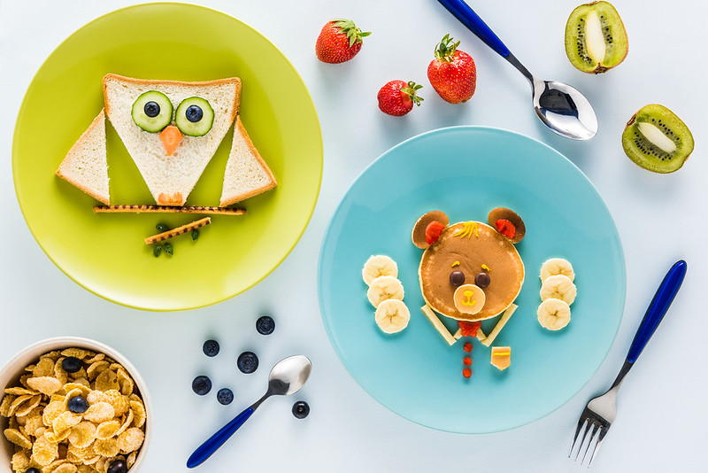 Plates of food cut up to look like animals.