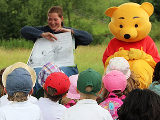 Winnie the Pooh at storytelling in Aldenham Country Park with children