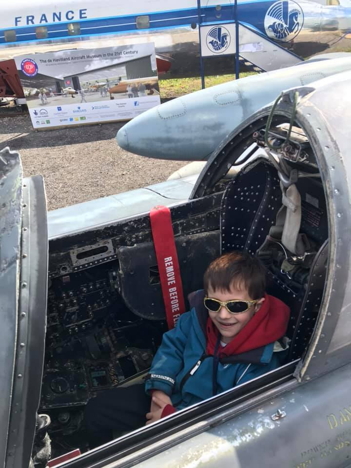 Young boy sitting in an aircraft at the DDe