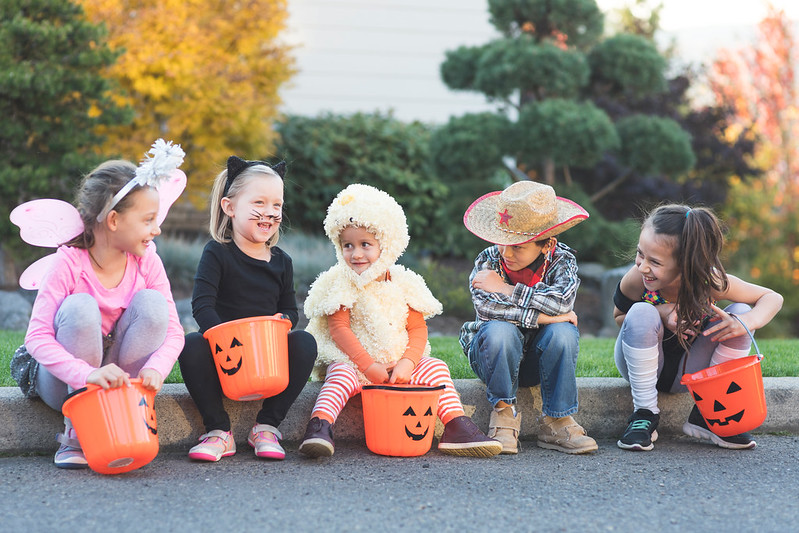 Kids tricking and treating during Halloween.