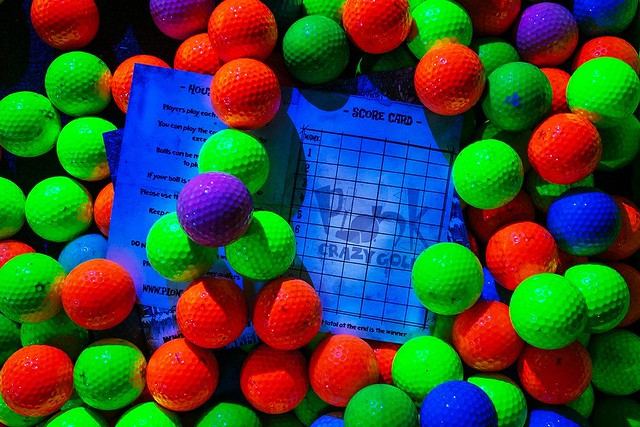 Brightly coloured neon golf ball at Plonk Crazy Golf