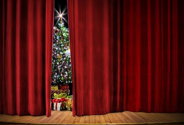 Christmas tree behind a curtain