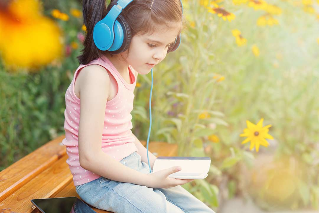 Child listening to podcast.