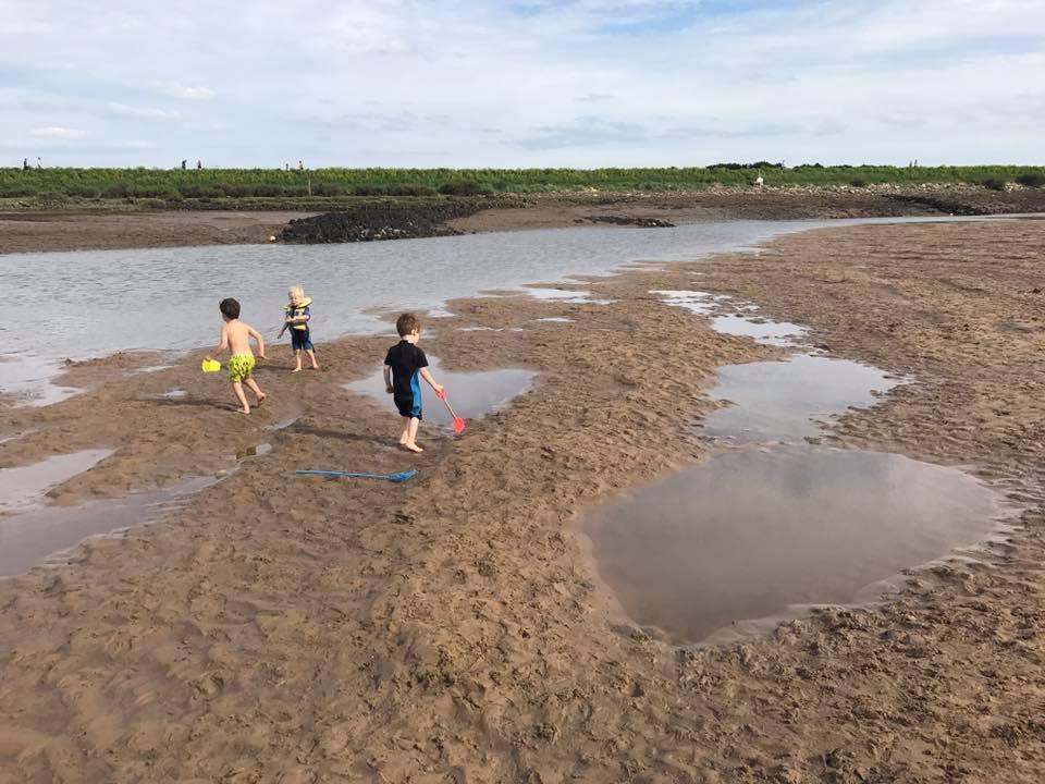 kids playing on norfolk beach