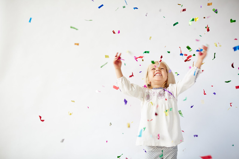 Child playing with confetti