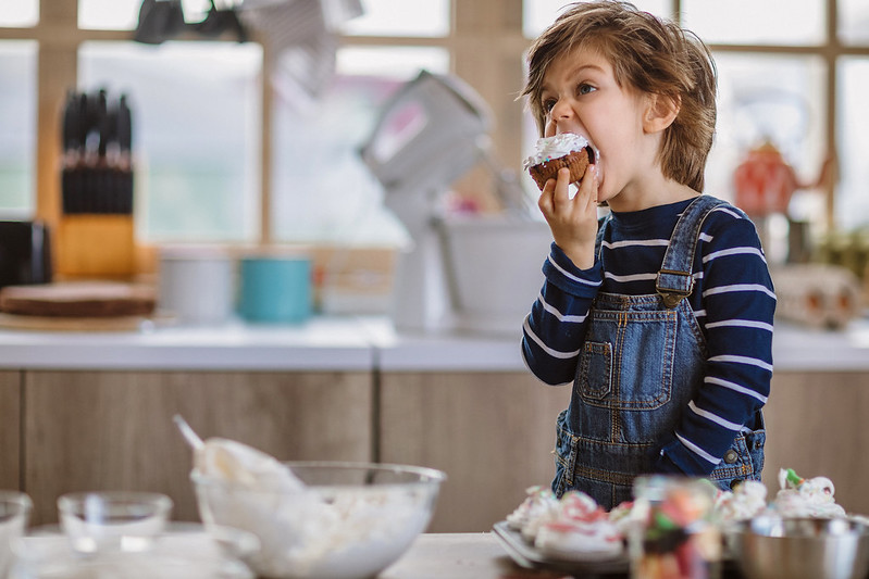 Child eating a homemade nut-free cupcake.