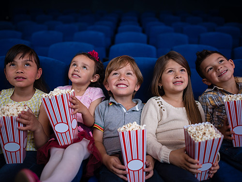Preschoolers watching a movie at the cinema.