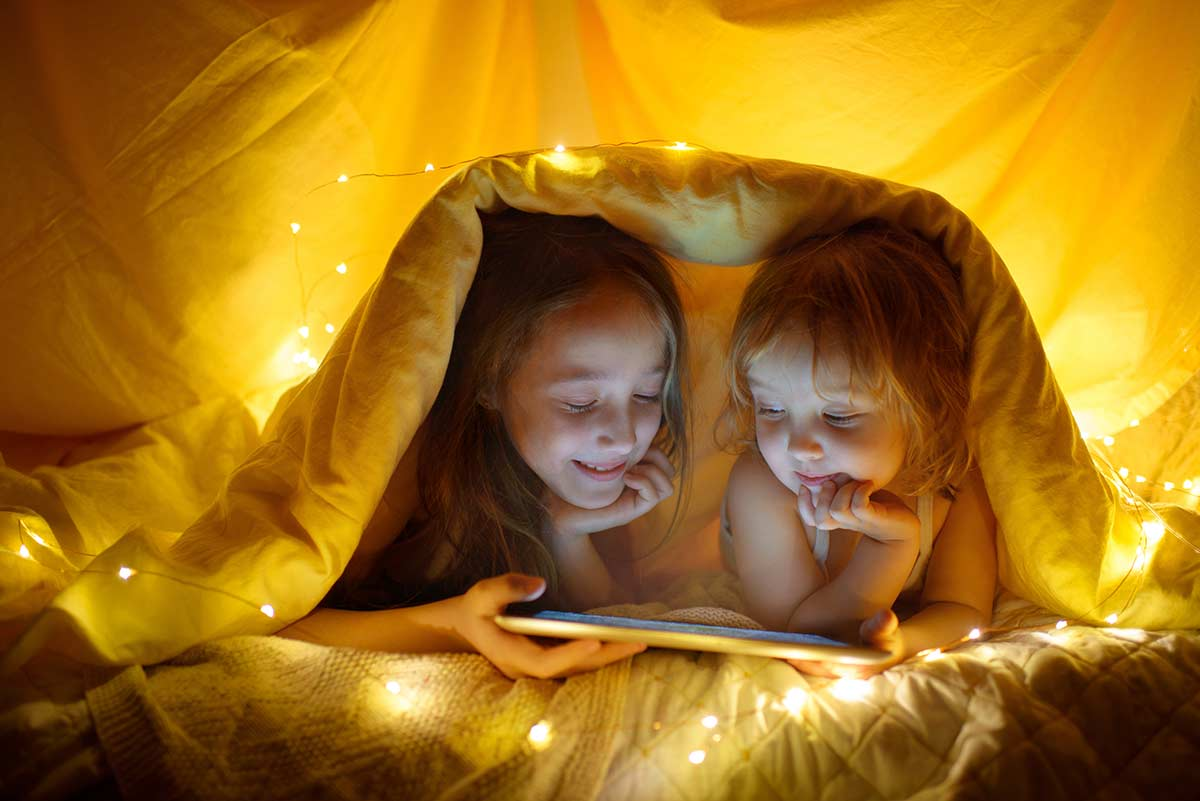 Telling stories under a blanket tent.