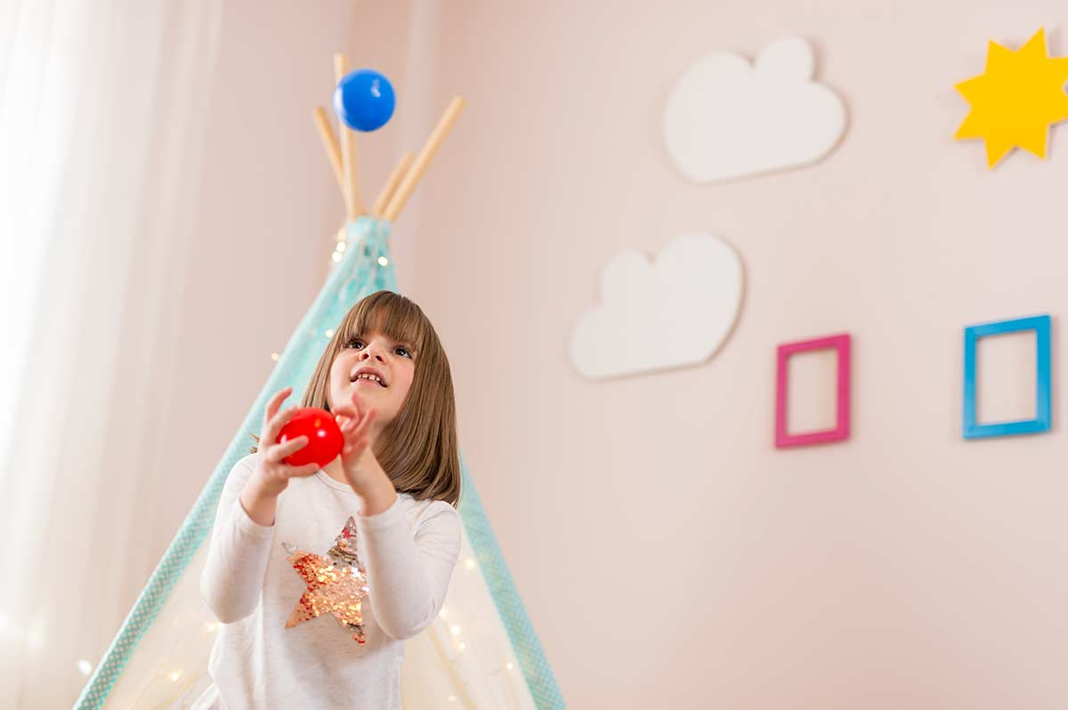 Girl learning circus skills in her bedroom.