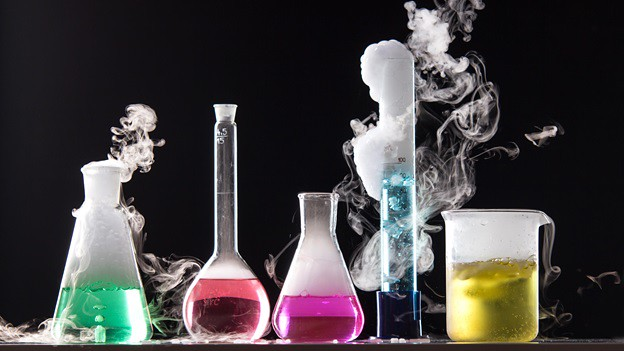 Science tubes and beakers bubbling and smoking with vibrant colours.