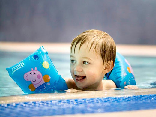 Little boy in a swimming pool