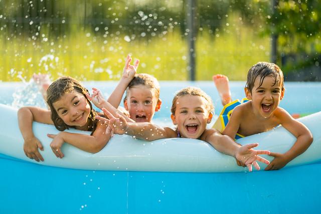 Four children enjoying summer