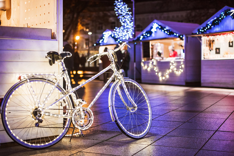 Bike covered in Christmas lights.