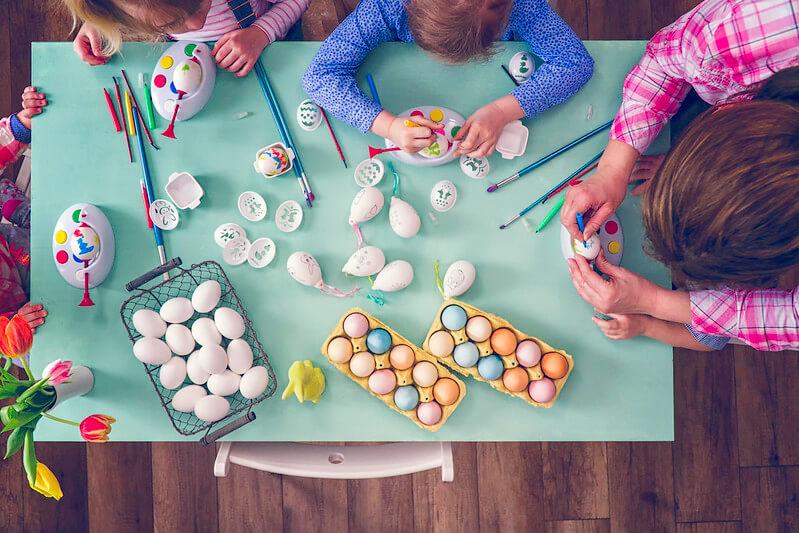 Family making Easter crafts together.