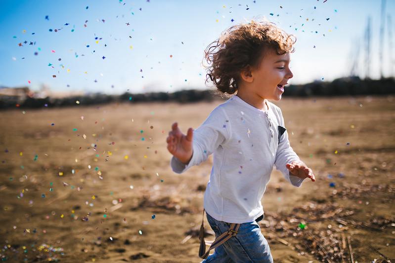 Boy running around in a field.