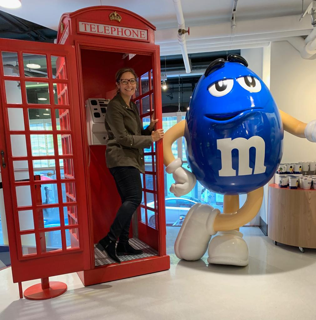 posing at the M&M store
