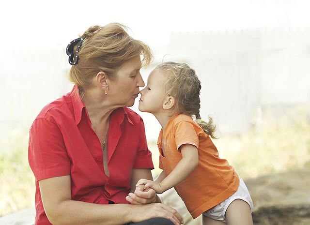 Grandma kissing at Jewish Care