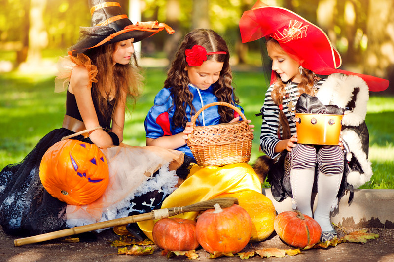 Girls dressed up for creating Halloween decorations.
