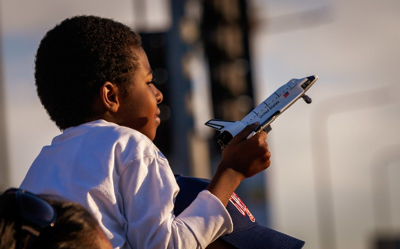 Young boy holding a toy plane