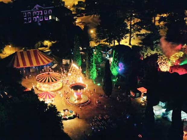 ariel view of enchanted horsham's fairground at night