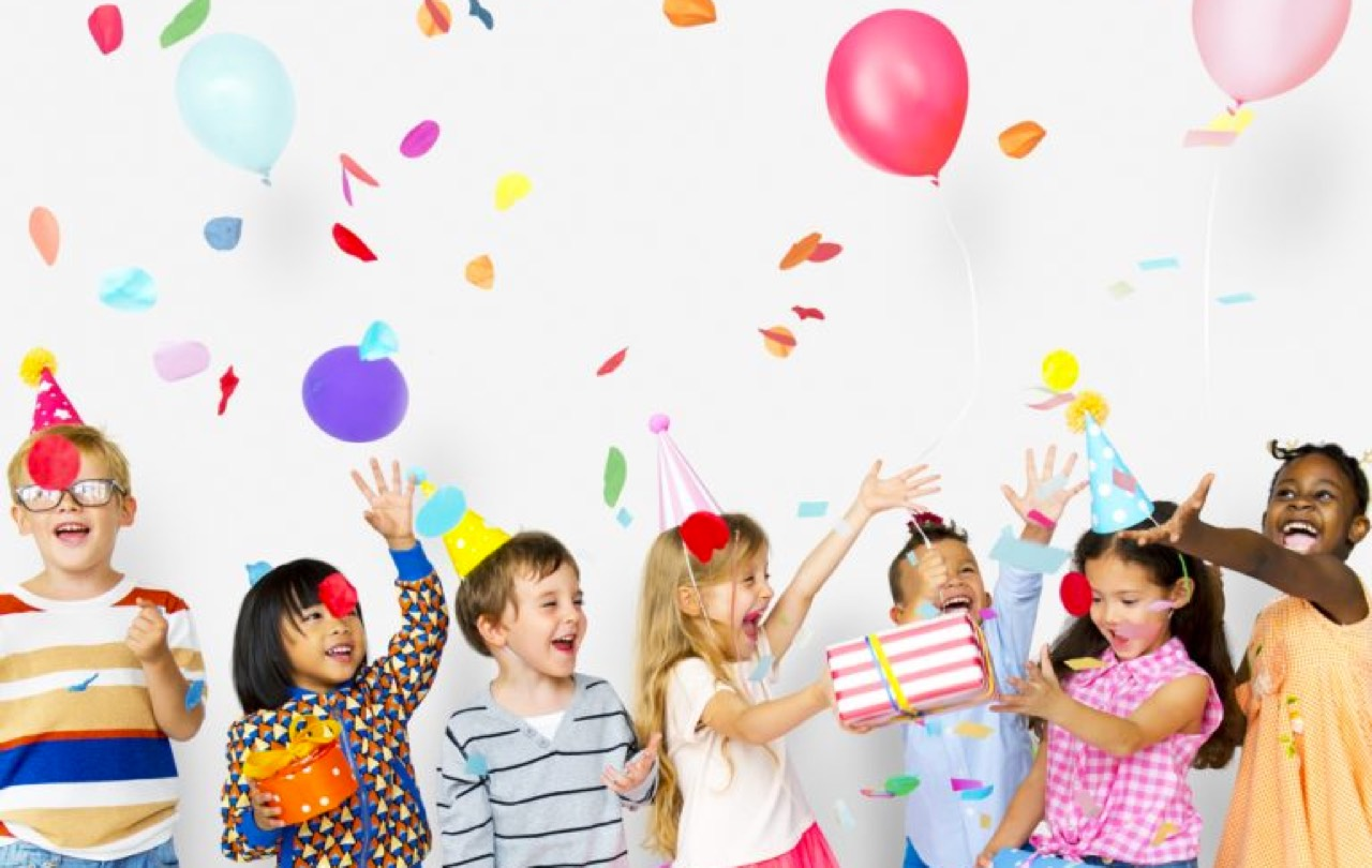 children throwing confetti and balloons