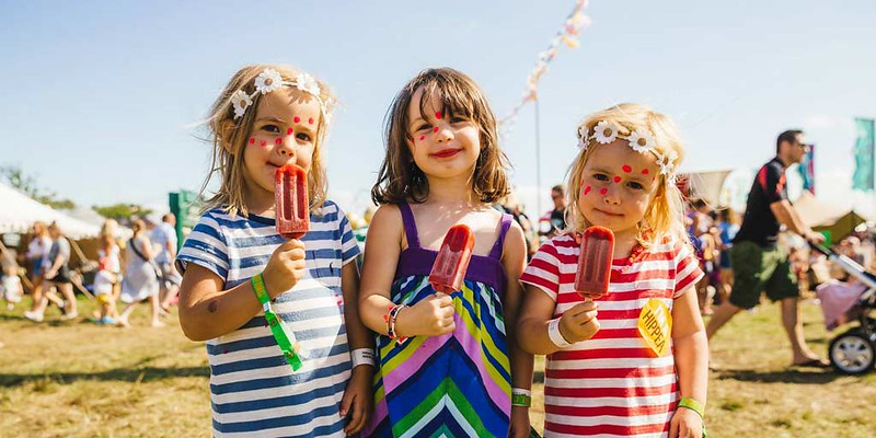 Three little girls at a festival on the weekend.