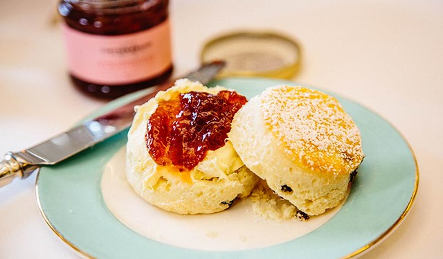 open scone with jam