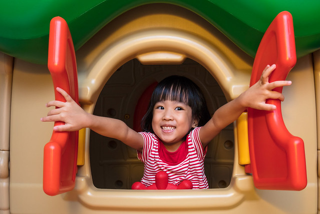 Girl enjoying a play in a playhouse