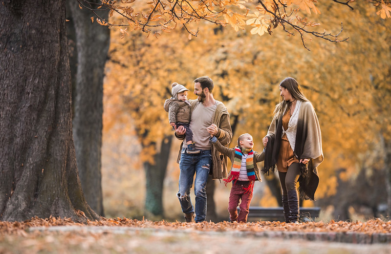 Family spending time in the forest in autumn