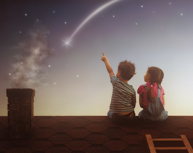 Children looking at space.