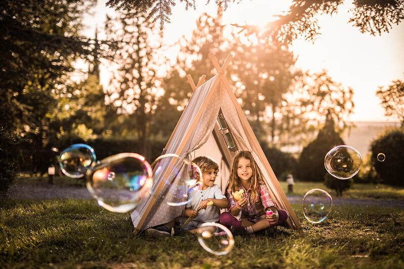 Making a tent and playing with bubbles in the garden.