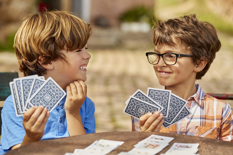Two brothers playing a new card game they've just learnt.