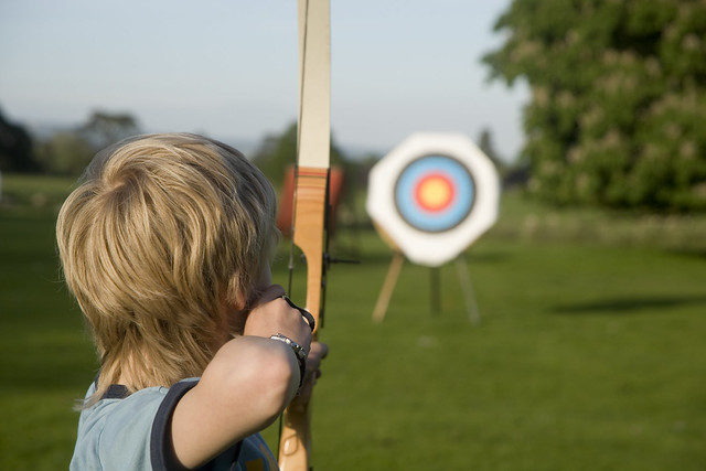 Boy playing the sporting activity of archery