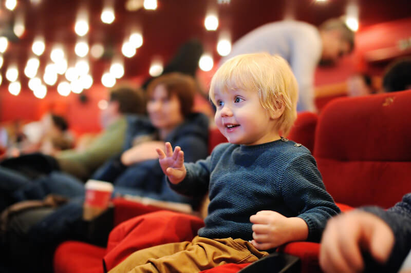 Boy at the cinema.