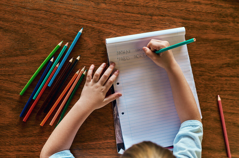 child writing for magazine