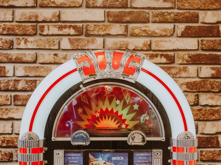 Jukebox against a brick wall.