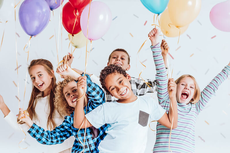 Children at a birthday party ready to dance to the ultimate kids party playlist to groove to