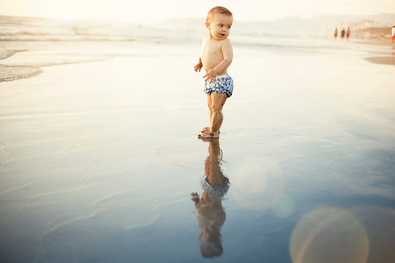 Boy with cornish boys name on beach