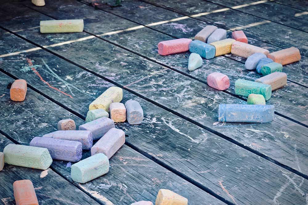 coloured chalks laid out on hard wood floor