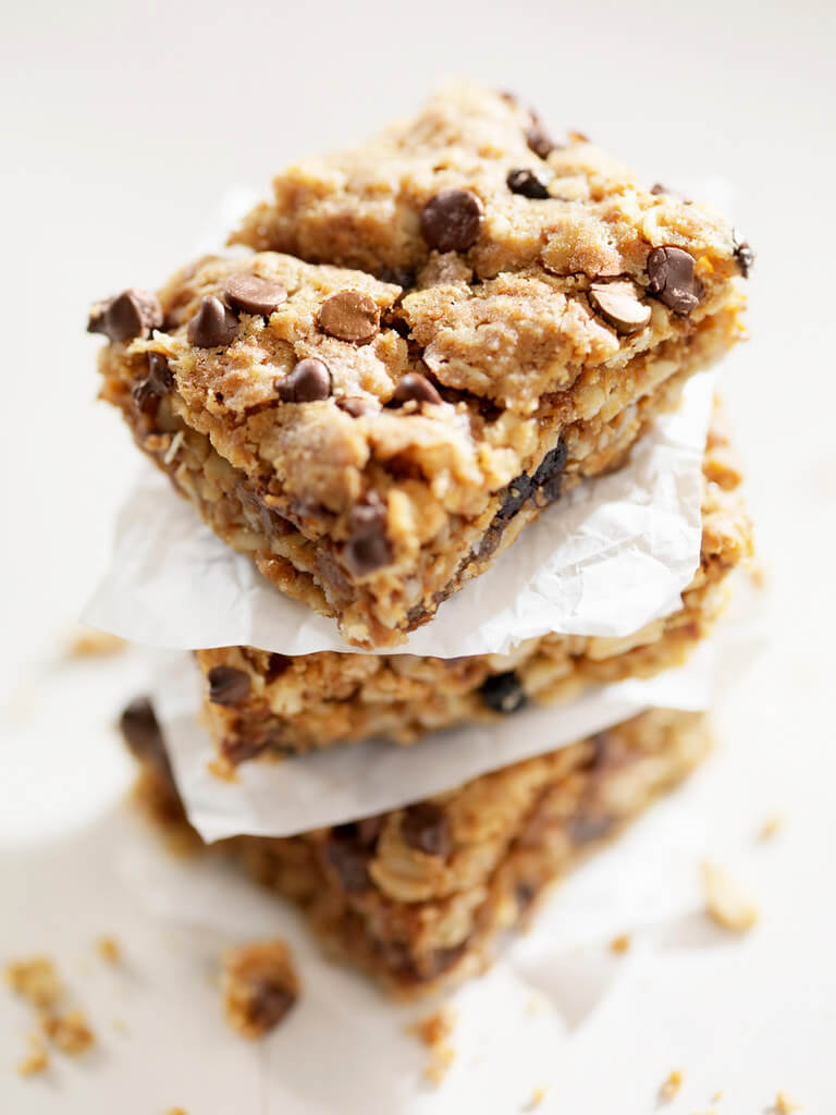 Chocolate chip flapjacks stacked on top of each other.