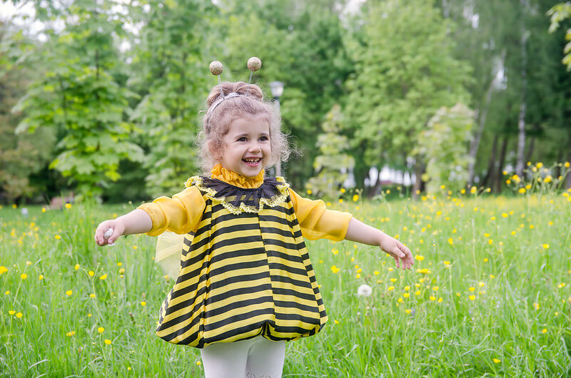 child with bee puns
