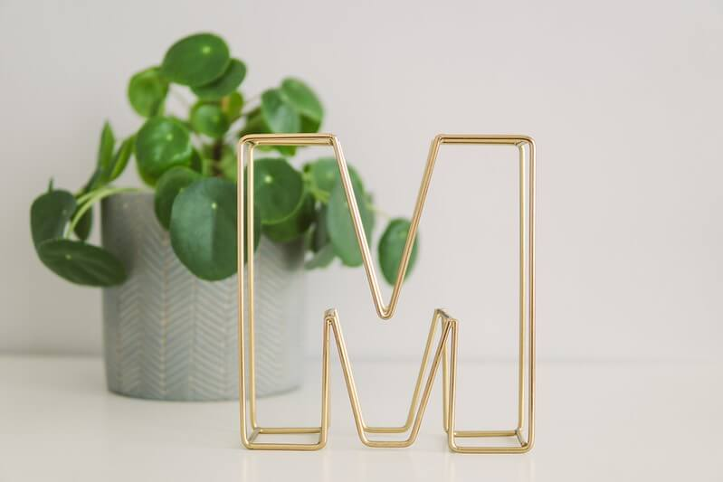 The letter M, representing marvellous girls' names beginning with M.